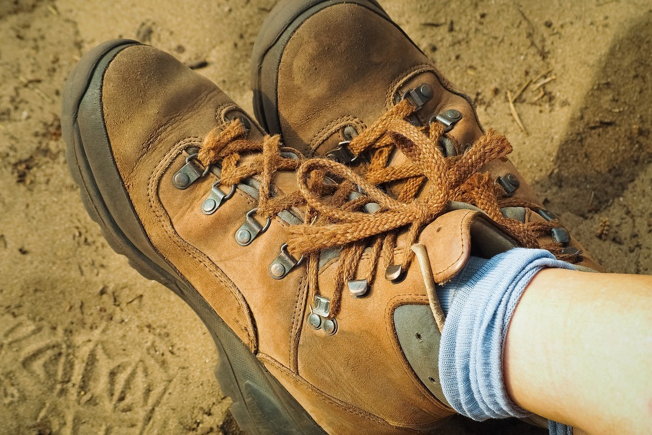 person wearing hiking shoes in a desert