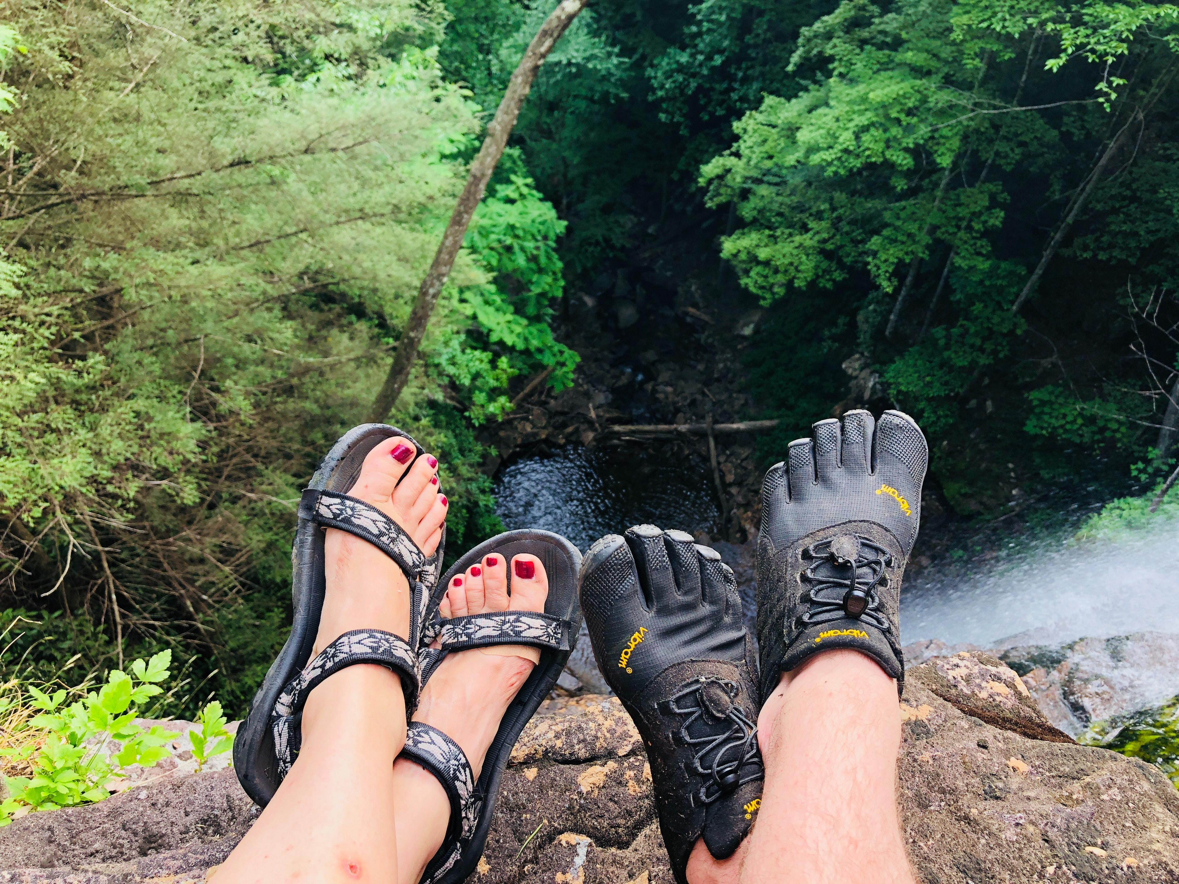 couple wearing hiking sandals Sandals