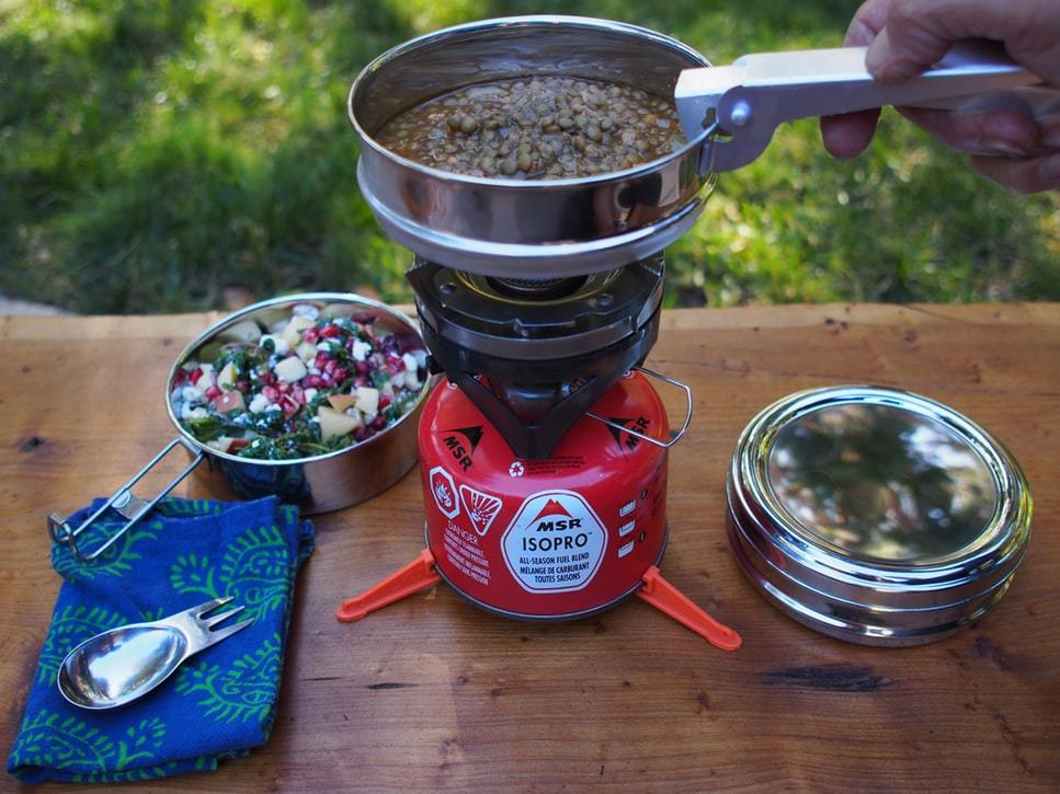 food and stove materials for camping in a table