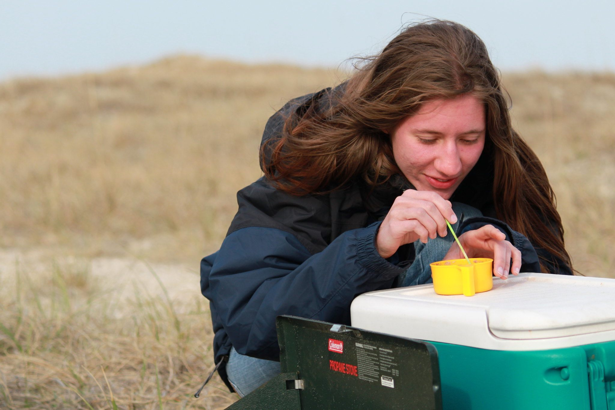 woman taking something in a cooler