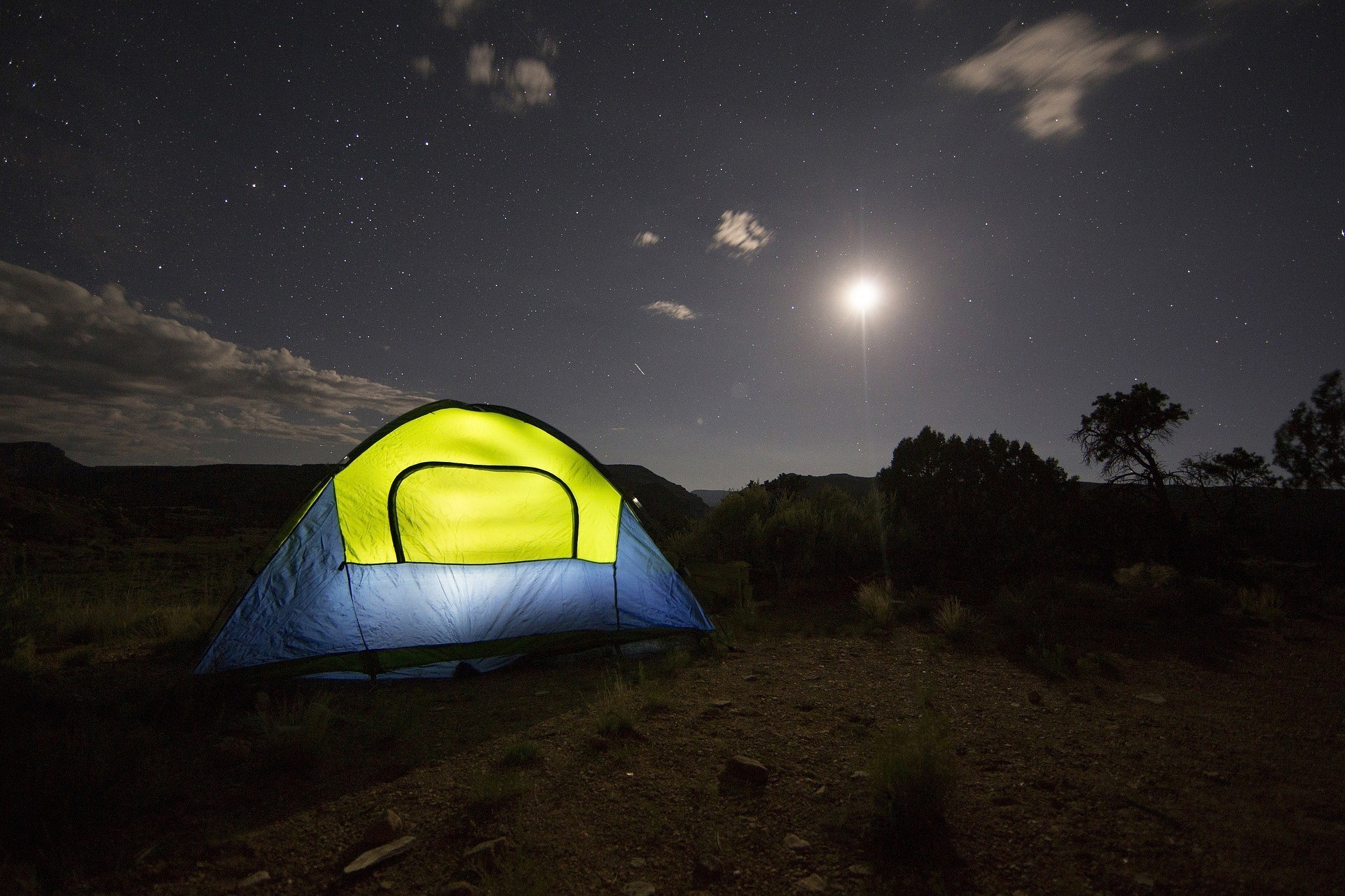 Camping tents in the mountain underneath the stars