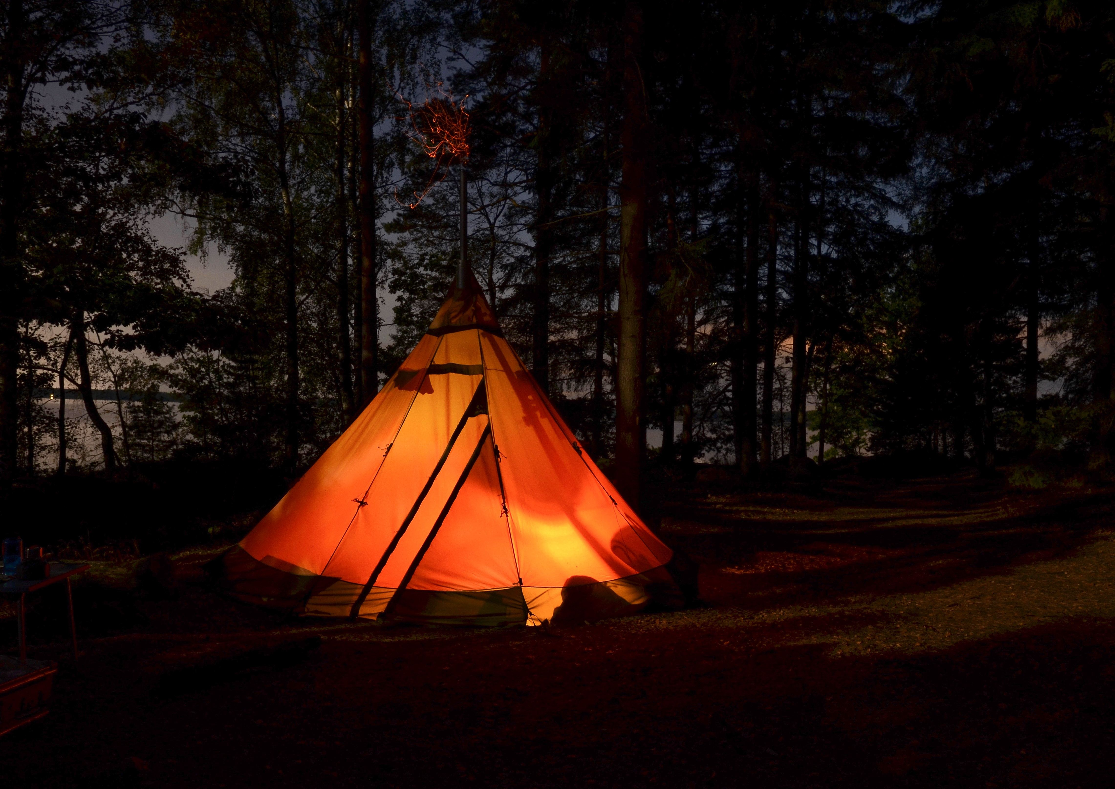 Lighted camping tent in the middle of the night