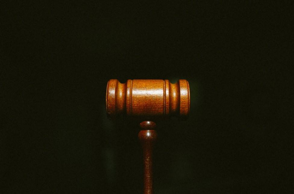 judges gavel on a black background representing law and legality of stealth camping